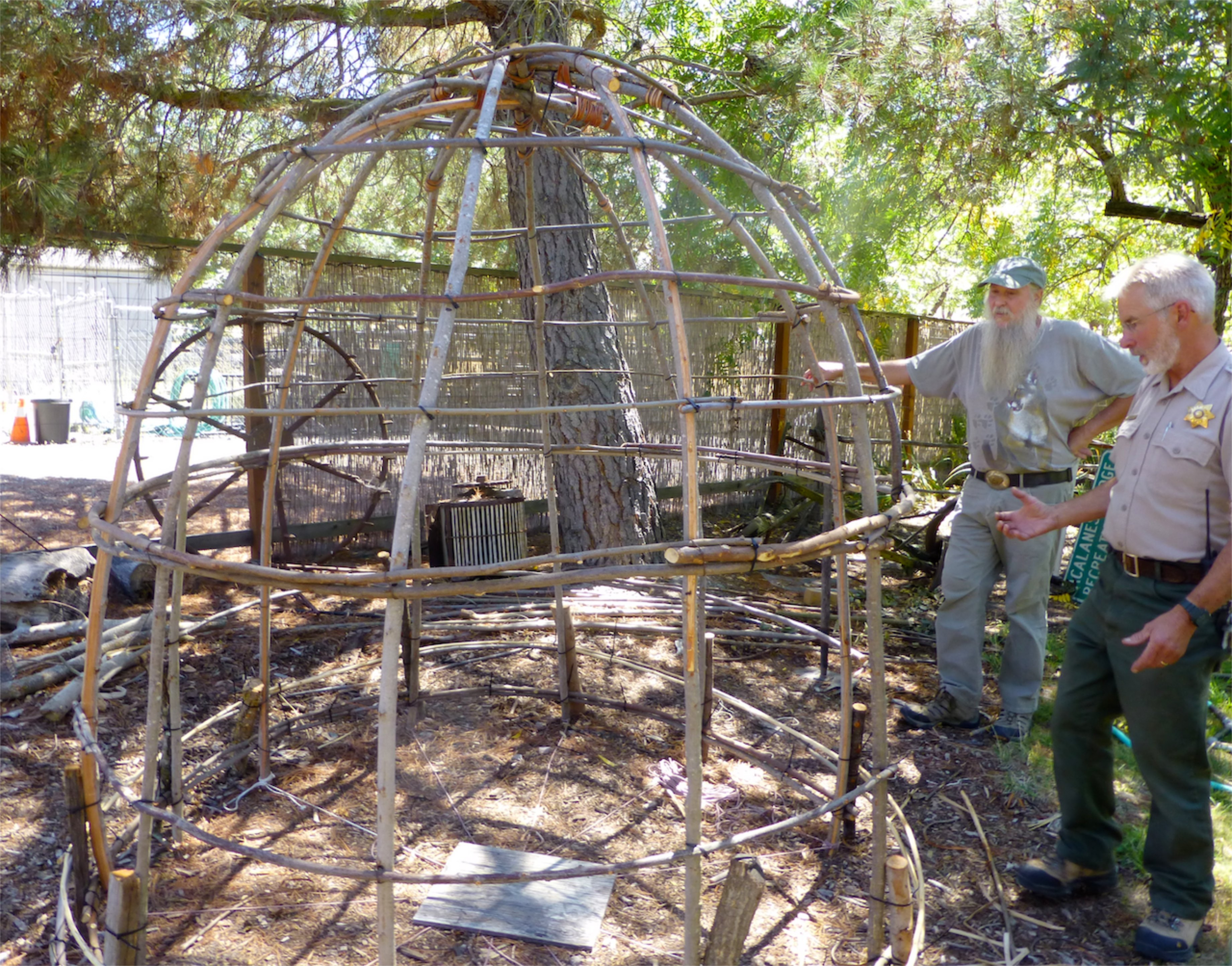 Ranger Bruce Weidman (right) and Doc Hale build a Miwok dwelling at Sugarloaf Open Space